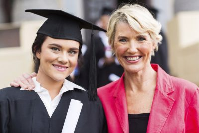 young female graduate and mother at ceremony
